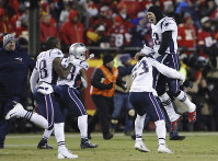 New England Patriots quarterback Tom Brady (12) celebrates with his teammates after the AFC Championship NFL football game, on Jan. 20, 2019, in Kansas City, Mo. (AP Photo/Charlie Neibergall)