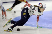 In this Nov. 13, 2016 file photo, first place finisher Shim Suk-hee, from South Korea, races during the women's 1,500-meter finals at a World Cup short track speed skating event at the Utah Olympic Oval in Kearns, Utah. (AP Photo/Rick Bowmer)