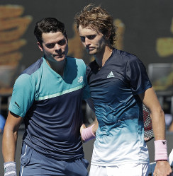 Canada's Milos Raonic, left, is congratulated by Germany's Alexander Zverev after winning their fourth round match at the Australian Open tennis championships in Melbourne, Australia, on Jan. 21, 2019. (AP Photo/Aaron Favila)