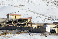 In this Jan. 21, 2019 photo, Afghan security forces inspect the site of a Taliban attack in Maidan Shar, capital of Maidan Wardak province, east of Kabul, Afghanistan. (AP Photo)