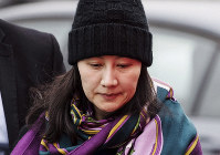 In this Dec. 12, 2018 file photo, Huawei chief financial officer Meng Wanzhou arrives at a parole office with a security guard in Vancouver, Canada. (Darryl Dyck/The Canadian Press via AP)