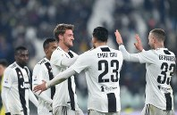 Juventus' Daniele Rugani, third form right, celebrates with his teammates after scoring his side's third goal during the Serie A soccer match between Juventus and Chievo Verona at the Allianz Stadium in Turin, Italy, on Jan. 21, 2019. (Alessandro Di Marco/ANSA via AP)