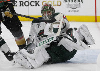 Minnesota Wild goaltender Devan Dubnyk (40) makes a save against the Vegas Golden Knights during the second period of an NHL hockey game on Jan. 21, 2019, in Las Vegas. (AP Photo/John Locher)