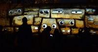 石垣に映し出されるさまざまな表情=大阪市中央区で2019年1月11日、望月亮一撮影