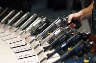 In this Jan. 19, 2016 file photo, handguns are displayed at the Smith & Wesson booth at the Shooting, Hunting and Outdoor Trade Show in Las Vegas. (AP Photo/John Locher)
