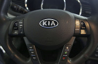 This Oct. 5, 2012, file photo, shows a Kia optima's steering wheel inside of a Kia car dealership in Elmhurst, Ill. (AP Photo/Nam Y. Huh)