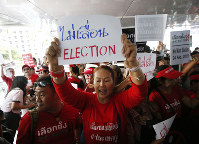 In this Jan. 8, 2019 file photo, demonstrators hold a rally demanding the general election not be postponed in Bangkok, Thailand. (AP Photo/Sakchai Lalit)