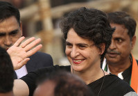 In this Feb. 16, 2017 file photo, Priyanka Gandhi Vadra, sister of Congress party President Rahul Gandhi, waves to party supporters during an election campaign rally in Rae Barelli, India. (AP Photo/Rajesh Kumar Singh)