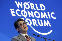 Japanese Prime Minister Shinzo Abe addresses the annual meeting of the World Economic Forum in Davos, Switzerland, on Jan. 23, 2019. (AP Photo/Markus Schreiber)