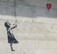 Photo shows graffiti that looks similar to Banksy's noted work