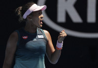Japan's Naomi Osaka reacts after winning the first set against Ukraine's Elina Svitolina during their quarterfinal match at the Australian Open tennis championships in Melbourne, Australia, on Jan. 23, 2019. (AP Photo/Kin Cheung)