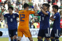 Japan's goalkeeper Shuichi Gonda, left, and Hidemasa Morita celebrate after the AFC Asian Cup round of 16 soccer match between Japan and Saudi Arabia at the Sharjah Stadium in Sharjah, United Arab Emirates, on Jan. 21, 2019. (AP Photo/Hassan Ammar)