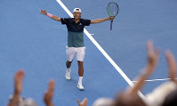 France's Lucas Pouille celebrates after defeating Canada's Milos Raonic in their quarterfinal match at the Australian Open tennis championships in Melbourne, Australia, on Jan. 23, 2019. (AP Photo/Mark Schiefelbein)