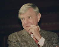In this Feb. 23, 1993 file photo, writer Russell Baker, ponders a reporter's question during a New York news conference where he was presented as the successor to host Alistair Cooke for the PBS series