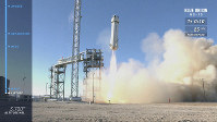 In this image from video made available by Blue Origin, the New Shepard capsule and booster lifts off from the company's site in west Texas. (Blue Origin via AP)