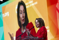 U.S. House Speaker Nancy Pelosi, D-Calif., speaks during the U.S. Conference of Mayors winter meeting in Washington, on Jan. 23, 2019. (AP Photo/Jose Luis Magana)