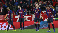 FC Barcelona's Gerard Pique, second left, reacts after Sevilla's Pablo Sarabia scored during a Spanish Copa del Rey soccer match between Sevilla and FC Barcelona in Seville, Spain, on Jan. 23, 2019. (AP Photo/Miguel Morenatti)