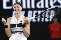Petra Kvitova of the Czech Republic celebrates after defeating after United States' Danielle Collins in their semifinal at the Australian Open tennis championships in Melbourne, Australia, on Jan. 24, 2019. (AP Photo/Kin Cheung)