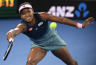 Japan's Naomi Osaka hits a forehand return to Karolina Pliskova of the Czech Republic during their semifinal at the Australian Open tennis championships in Melbourne, Australia, on Jan. 24, 2019. (AP Photo/Andy Brownbill)