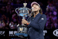 Japan's Naomi Osaka poses with her trophy after defeating Petra Kvitova of the Czech Republic during the women's singles final at the Australian Open tennis championships in Melbourne, Australia, Saturday, Jan. 26, 2019. (AP Photo/Aaron Favila)