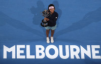 Japan's Naomi Osaka poses with her trophy after defeating Petra Kvitova of the Czech Republic during the women's singles final at the Australian Open tennis championships in Melbourne, Australia, Saturday, Jan. 26, 2019. (AP Photo/Kin Cheung)