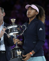 Japan's Naomi Osaka holds the trophy after defeating Petra Kvitova of the Czech Republic during the women's singles final at the Australian Open tennis championships in Melbourne, Australia, Saturday, Jan. 26, 2019. (AP Photo/Aaron Favila)