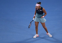 Japan's Naomi Osaka reacts after winning a point against Petra Kvitova of the Czech Republic during the women's singles final at the Australian Open tennis championships in Melbourne, Australia, Saturday, Jan. 26, 2019. (AP Photo/Kin Cheung)