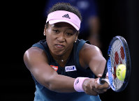 Japan's Naomi Osaka makes a backhand return to Petra Kvitova of the Czech Republic during the women's singles final at the Australian Open tennis championships in Melbourne, Australia, Saturday, Jan. 26, 2019. (AP Photo/Aaron Favila)