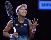 Japan's Naomi Osaka reacts after losing a point to Petra Kvitova of the Czech Republic during the women's singles final at the Australian Open tennis championships in Melbourne, Australia, Saturday, Jan. 26, 2019. (AP Photo/Aaron Favila)