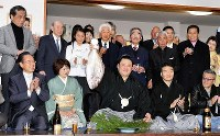New Year Grand Sumo Tournament champion Tamawashi, front center, holding a sea bream, a good luck fish, appears at a celebration after his tourney victory on Jan. 27, 2019, in Tokyo's Sumida Ward. (Mainichi/Naoki Watanabe)