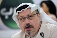 In this Dec. 15, 2014 file photo, Saudi journalist Jamal Khashoggi speaks during a press conference in Manama, Bahrain. (AP Photo/Hasan Jamali)