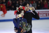 Wenjing Sui and Cong Han, of China, hold their gold medals after winning the pairs competition at the Four Continents Figure Skating Championships on Saturday, Feb. 9, 2019, in Anaheim, Calif. (AP Photo/Chris Carlson)