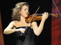 In this Dec. 18, 2008 file photo, German violinist Anne-Sophie Mutter performs during the Jose Carreras Gala rehearsal in Leipzig, eastern Germany. (AP Photo/Eckehard Schulz)