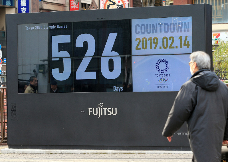 1af71b425112 A board in front of JR Shimbashi Station in Tokyo s Minato Ward shows there  are 526 days before the start of the Tokyo Olympics