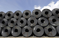 In this June 5, 2018, file photo, rolls of steel are shown in Baytown, Texas.(AP Photo/David J. Phillip)