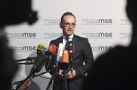 German Minister of Foreign Affairs Heiko Maas talks to the media at the Munich Security Conference in Munich, Germany, on Feb. 15, 2019. (Tobias Hase/dpa via AP)