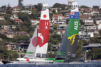 The Japanese team, left, and the Australia team start the final SailGP race on their F50 catamarans in Sydney Harbour, in Sydney, Australia, on Feb. 16, 2019. (AP Photo/Rick Rycroft)