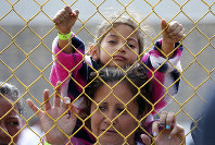 Six-year-old Daniela Fernanda Portillo Burgos sits on the shoulders of her mother, Iris Jamilet, 39, as they look out through the fence of a immigrant shelter in Piedras Negras, Mexico, Tuesday, Feb. 5, 2019. A caravan of about 1,600 Central American migrants camped Tuesday in the Mexican border city of Piedras Negras, just west of Eagle Pass, Texas. The governor of the northern state of Coahuila described the migrants as