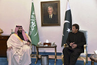 In this photo released by the Press Information Department of Pakistan, visiting Saudi Arabia's Crown Prince Mohammed bin Salman, left, listens to Pakistani Prime Minister Imran Khan during a meeting in Islamabad, Pakistan, on Feb. 17, 2019. (Press Information Department, via AP)