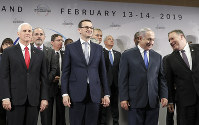 In this Feb. 14, 2019 file photo, United States Vice President Mike Pence, Prime Minister of Poland Mateusz Morawiecki, Israeli Prime Minister Benjamin Netanyahu and United State Secretary of State Mike Pompeo, from left, stand on a podium at a conference on Peace and Security in the Middle East in Warsaw, Poland. (AP Photo/Michael Sohn)