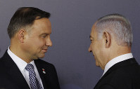 In this Feb. 13, 2019 file photo, Polish President Andrzej Duda, left, and Israeli Prime Minister Benjamin Netanyahu, talk after a group photo during a two-day international conference on the Middle East, at the Royal Castle in Warsaw, Poland. (AP Photo/Czarek Sokolowski)