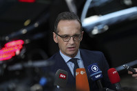 Germany's Foreign Minister Heiko Maas speaks with the media as he arrives to an EU Foreign Ministers meeting at the European Council headquarters in Brussels, on Feb. 18, 2019. (AP Photo/Francisco Seco)