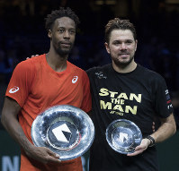 Gael Monfils of France holds the trophy as he celebrates winning against Stan Wawrinka of Switzerland, right, in three sets, 6-3, 1-6, 6-2, in the men's singles final of the ABN AMRO world tennis tournament at Ahoy Arena in Rotterdam, Netherlands, on Feb. 17, 2019. (AP Photo/Peter Dejong)