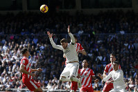 Real Madrid's Sergio Ramos, center, gestures after heading the ball during a La Liga soccer match between Real Madrid and Girona at the Bernabeu stadium in Madrid, Spain, on Feb. 17, 2019. (AP Photo/Andrea Comas)