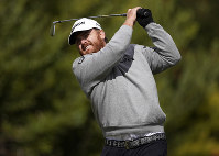 J.B. Holmes hits his tee shot on the fourth hole during the final round of the Genesis Open golf tournament at Riviera Country Club on Feb. 17, 2019, in the Pacific Palisades area of Los Angeles. (AP Photo/Ryan Kang)