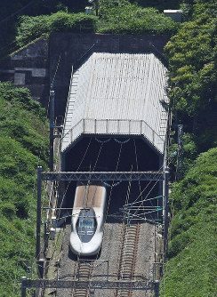 In this June 2018 file photo, a bullet train passes through a tunnel on the Sanyo Shinkansen line in Hatsukaichi, Hiroshima Prefecture. (Mainichi)