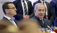 In this Feb. 14, 2019 photo, Poland's Prime Minister Mateusz Morawiecki, left, and Israeli Prime Minister Benjamin Netanyahu, right, attend a meeting in Warsaw, Poland. (AP Photo/Michael Sohn)
