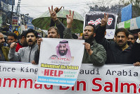 Pakistani Kashmiris rally to express solidarity with Indian Kashmiris on the occasion of the Saudi Crown Prince's visit to Pakistan, in Muzaffarabad, capital of Pakistani Kashmir, on Feb. 18, 2019. (AP Photo/M.D. Mughal)