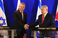 Prime Minister of Slovakia Peter Pellegrini, left, shake hands with Israeli Prime Minister Benjamin Netanyahu after their meeting in Jerusalem, on Feb. 19, 2019. (AP Photo/Ariel Schalit, Pool)