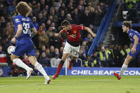 Manchester United's Ander Herrera, center, scores the opening goal of the game during the English FA Cup fifth round soccer match between Chelsea and Manchester United at Stamford Bridge stadium in London, on Feb. 18, 2019. (AP Photo/Alastair Grant)